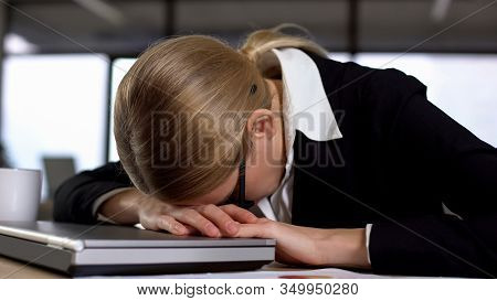 Female Employee Lying On Laptop, Annoyed With Work, Nervous Breakdown, Stress