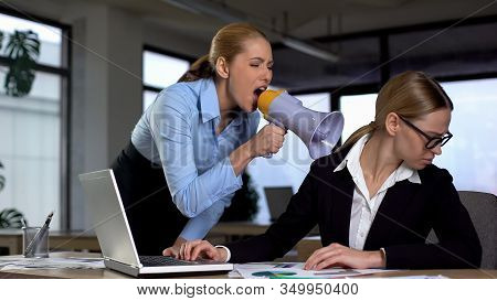 Female Boss Screaming With Megaphone At Colleague, Authoritarian Leadership