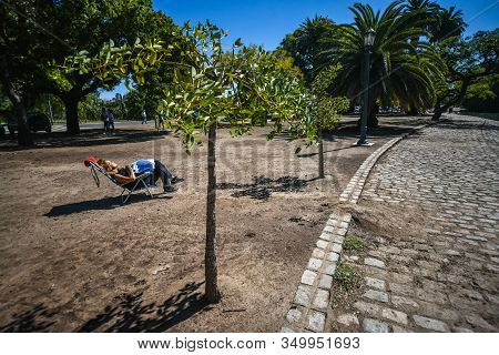 Buenos Aires, Argentina - 1 Apr, 2017: A Woman Is Sunbathing In The Palermo Woods Urban Park (spanis