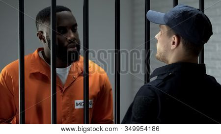 Afro-american Prisoner Making Arrangement With Prison Guard, Corruption In Jail
