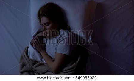Young Woman Sleeping In Comfortable Bed At Home, Sleeping Quality, Tranquility