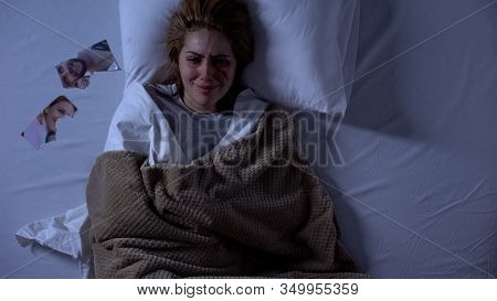 Crying Woman With Wound On Face Lying In Bed, Torn Photo Near Pillow, Breakup
