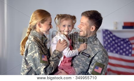 Smiling Couple Of American Soldiers Holding Daughter, Rejoicing Homecoming, Duty