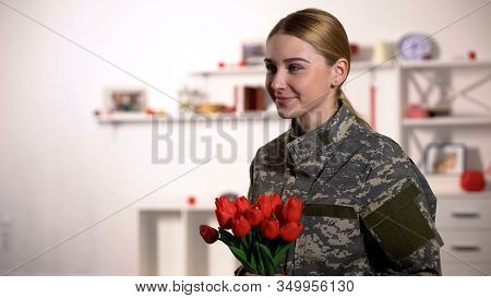 Joyful Female Sergeant Rejoicing Tulips Bouquet And Smiling Homecoming After War
