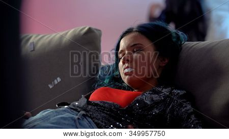 Unconscious Junkie Girl Mouth Foaming At Party In Night Club, Indifferent People