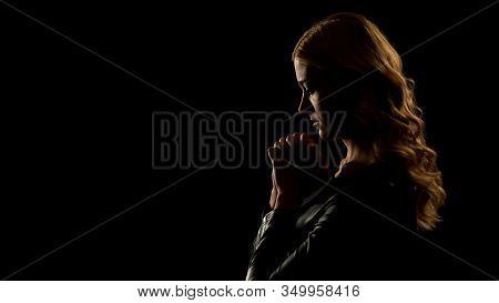 Blond Woman Praying In Dark Place, Asking For Forgiveness, Sinner Confession