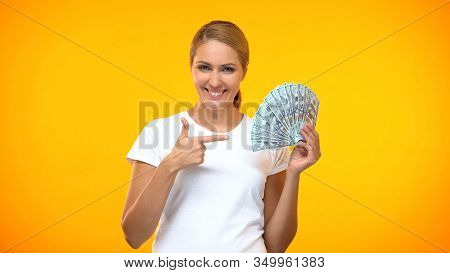 Happy Young Lady Pointing At Dollar Banknotes Hand, Passive Income, Investment