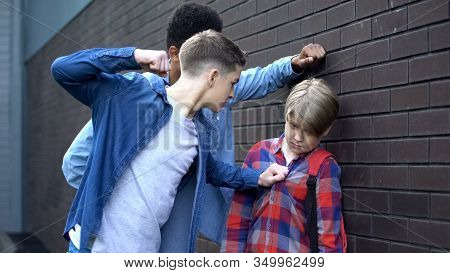 Cruel Students Threatening To Punch Junior Boy, School Bullying, Intimidation
