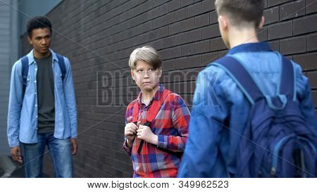 Cruel Teenagers Threatening Younger Boy, Physical Intimidation, School Bullying