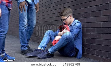 Teen Boy Leaning Against Wall, Scared Of Bully Students, Intimidation At School