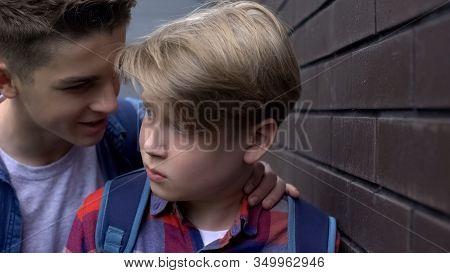 Cruel Teenage Boy Threatening Depressed Student, Verbal Abuse, Intimidation