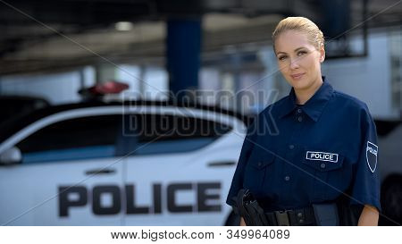 Female Police Officer Smiling, Standing Near Patrol Car, Maintenance Of Order