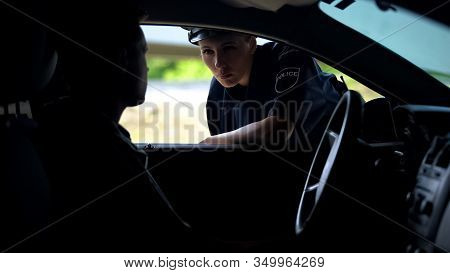 Police Woman Talking With Driver In Car, Inspection On Road, Traffic Offence