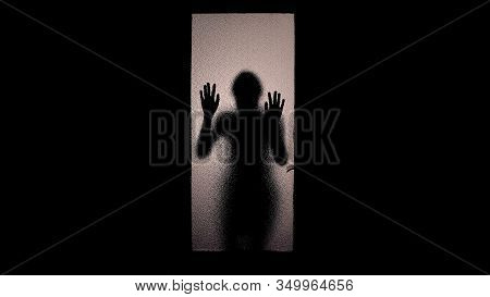 Shadow Of Scared Woman Knocking At Glass Door, Escape From Captivity, Violence