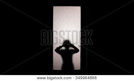 Little Girl Silhouette Watching Through Glass Door, Spooky Paranormal Phenomena