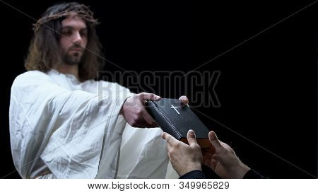 Messiah Giving Bible To Man On Dark Background, Holy Scripture, Religious Help