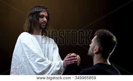 Son Of God Holding Hands Of Praying Man, Spiritual Support, Absolution Of Sins