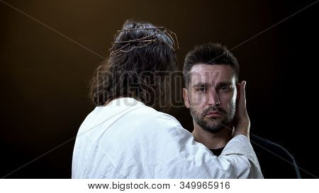 Messiah In White Cloth Hugging Crying Desperate Male, Religious Support, Faith