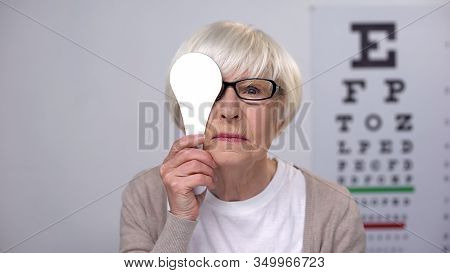 Female Retiree In Glasses Closing Eye And Shaking Head, Age Related Diseases