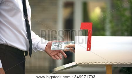 Man Receiving Dollars From Mailbox, Using Transfer Service, Financial Operations