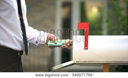 Man Receiving Euros From Mailbox, Using Transfer Service, Financial Operations