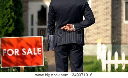 Inexperienced Broker Crossing Fingers Behind His Back Before Selling House, Luck