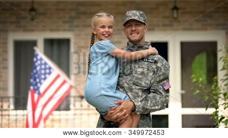 Handsome Usa Soldier In Military Uniform Holding Happy Daughter, Homecoming