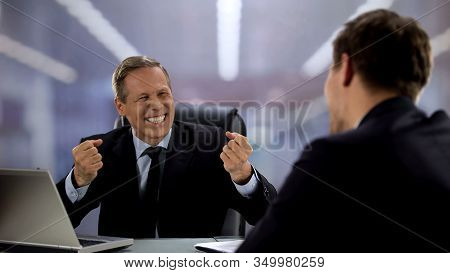Employer And Employee Laughing And Discussing Yesterday Football Match, Fun