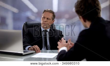 Male Worker Talking To Arrogant Boss Ignoring Him, Opinion Indifference At Work