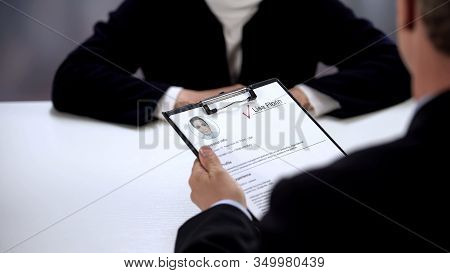 Company Boss Holding Curriculum Vitae Of Candidate, Marked Name, Job Interview
