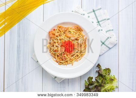 Delicious Spaghetti Spicy With Tobiko With Tablecloth On White Wood Plank Table Top With Raw Food Ma