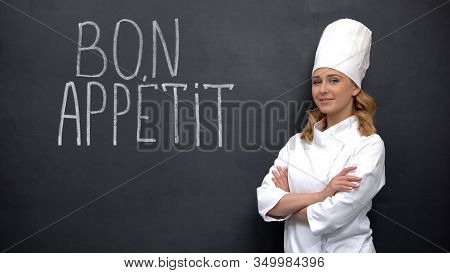 Female Chef Standing Near Bon Appetite French Phrase, Advertise Of Elite Kitchen