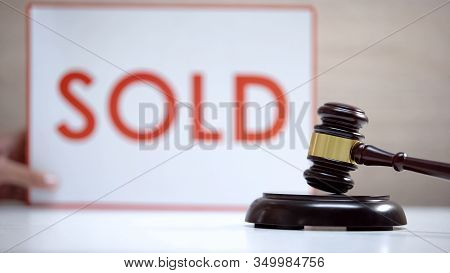 Gavel Standing Sound Block Against Sold Sign Background, Court Decision, Auction