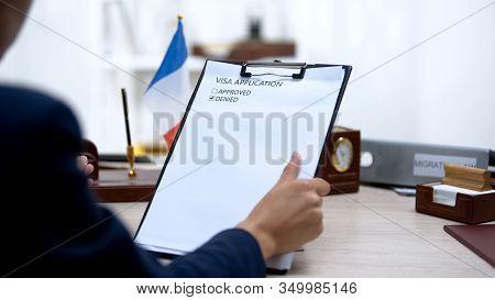 Immigration Inspector Denying Visa Application, French Flag Table, Citizenship