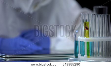 Fuel Lab Assistant Looking At Test Tube With Petrol For Sediment Quality Control