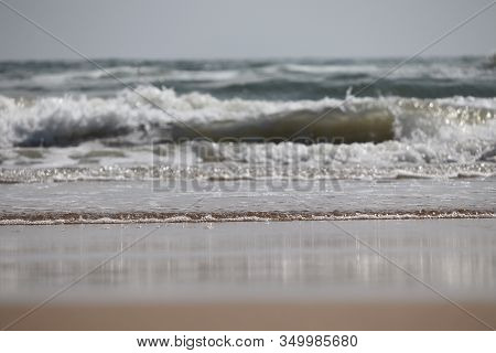 Brilliant Shot Of Big Wave Of Sea Water On The Beach Against Blue Sky With Sandy Foreground, Beach L