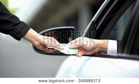 Female Hand Taking Euro Banknote From Driver Hand, Autobahn Payment, Order