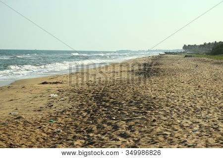 Brilliant Coastline On Blue Beach Against Blue Sharp Sky With Human Foot Mark On Sandy Beach In Bay