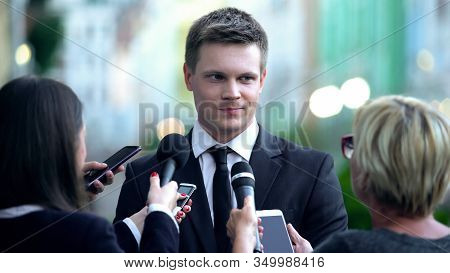 Smiling Male Millionaire Giving Interview On Press Conference, Public Relations