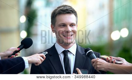 Smiling Man In Suit Giving Interview To Journalists, Evening News Broadcasting