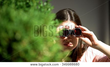 Jealous Woman With Binoculars Hiding Behind Tree Spying For Husband, Betrayal