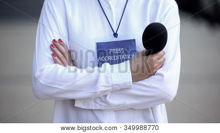 Woman With Microphone And Press Accreditation Card, Media Pass For Journalist