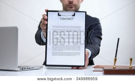 Business Lawyer Holding Contract, Notary Service Of Sale And Purchase Agreements