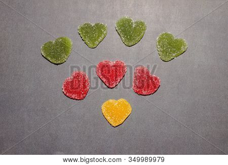 Marmalade In Sugar On A Chalk Board Background. Marmalade Multicolored Sweets In The Shape Of A Hear
