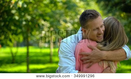 Cheerful Man Hugging Girlfriend, Affection Closeness, Friendly Relationship