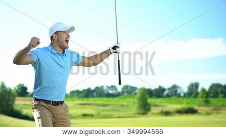 Beginner Golf Player With Club In Hand Rejoicing Successful Shot, Luck And Sport