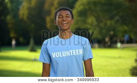 Teen Male Activist Sincerely Smiling On Camera, Eco Volunteering Project, Help