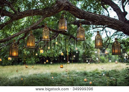 Evening Wedding Ceremony With A Lot Of Vintage Lanterns, Lamps, Candles. Unusual Outdoor Ceremony De