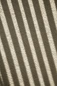 Shadows on a stucco wall for texture/background poster