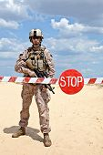 US marine with assault rifle near the barrier at a checkpoint poster